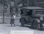 suffragette_handing_out_information__c-_1916__candee__19_268-2030-800-600-80-wm-center_bottom-50-watermarkphotos2png