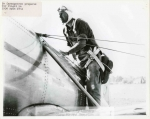 mss253-2-b-ev-cassagneres-readying-for-a-flight-in-the-1936-ryan-st-a2-1655-800-600-80-wm-center_bottom-50-watermark2png