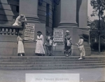 suffragettes_putting_up_signs__c-_1916__candee__19_258-2034-800-600-80-wm-center_bottom-50-watermarkphotos2png